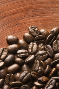 Coffee beans on brown background.